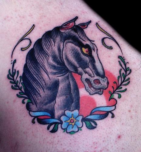 Häst i en symbol title=